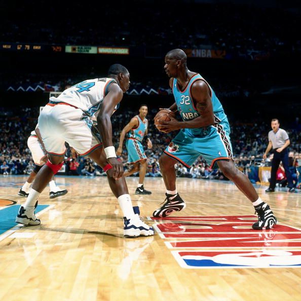 Shaquille O'Neal wearing the Reebok Shaqnosis; Hakeem Olawjuon wearing the Spalding Hakeem The Dream