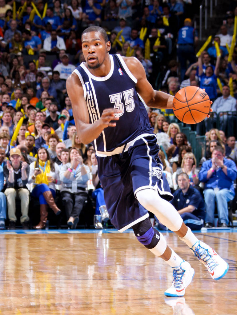 Kevin Durant wearing Oklahoma City Thunder Alternate Uniform and Nike KD V Home