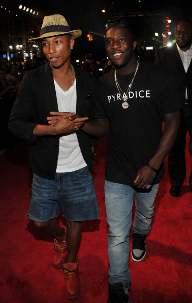 Pharrell Williams wearing Bee Line x Timberland Boots; Nigel Sylvester wearing Air Jordan I 1 Retro High OG Black Grey