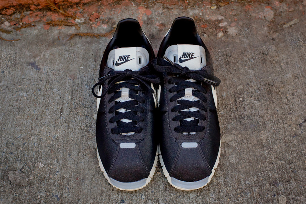 sale retailer c8e97 bc033 Pick up the Black Sail Cortez NM QS at select Nike Sportswear retailers  like Kith NYC now.