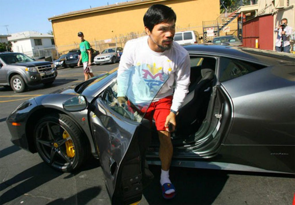 Manny Pacquiao wearing the Nike MP Solarsoft Slide