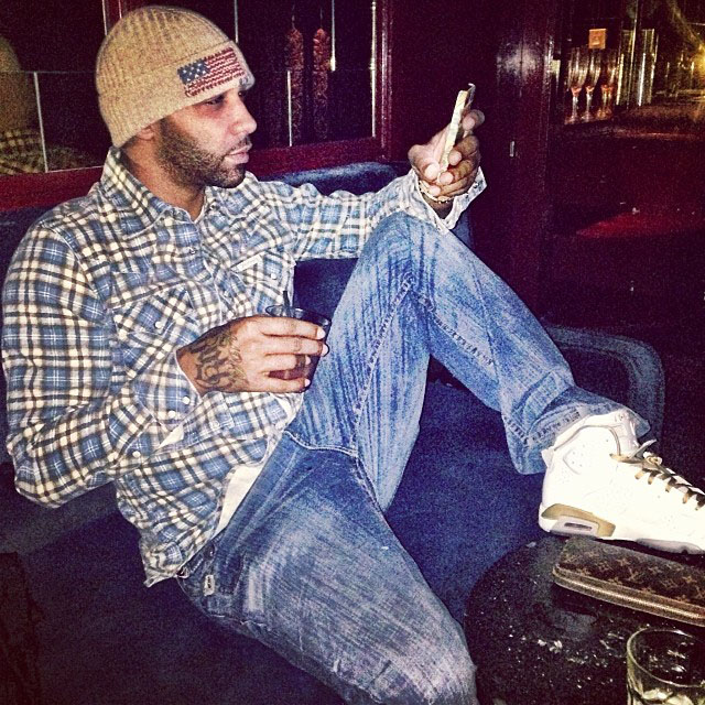 Joe Budden wearing Air Jordan 6 Retro Golden Moments