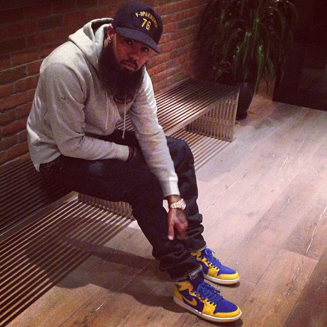 Stalley wearing Air Jordan 1 I Retro Laney