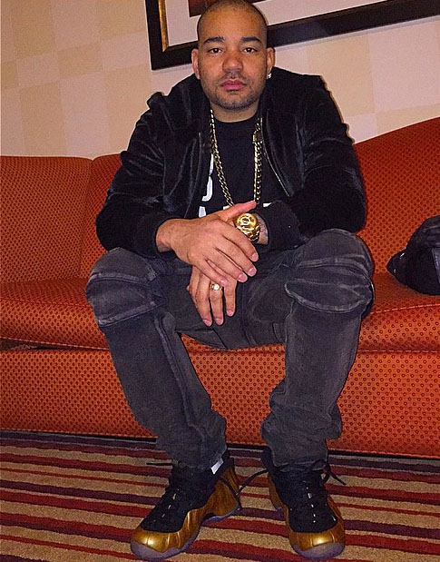 DJ Envy wearing Nike Air Foamposite One Gold