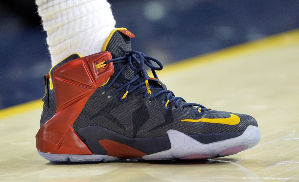 LeBron James wearing Blue/Red-Yellow Nike LeBron XII 12 PE on October 30, 2014