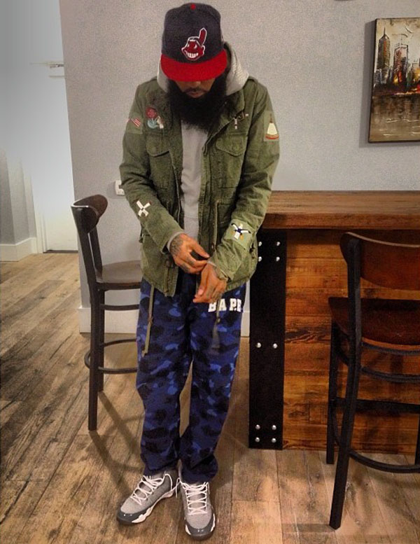 Stalley wearing Air Jordan 9 Retro Cool Grey