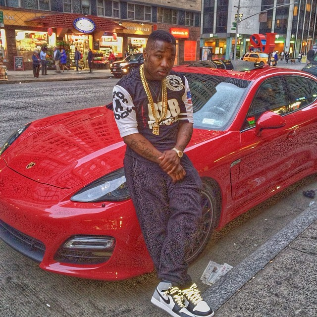 Troy Ave wearing Air Jordan I 1 Barons