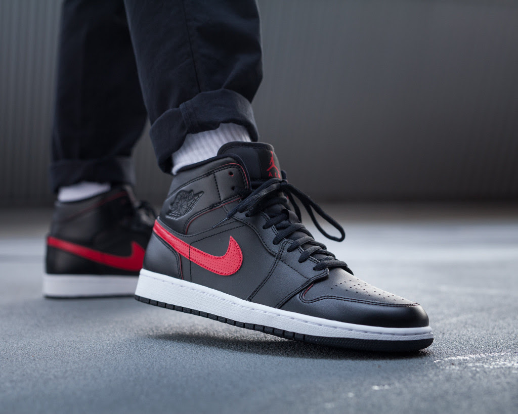 91f892440bf10d ... coupon code for air jordan 1 mid black red on foot right toe 554724 009  ea16a