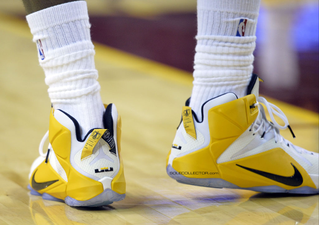 LeBron James wearing Nike LeBron XII 12 White/Yellow-Blue PE on November 19, 2014