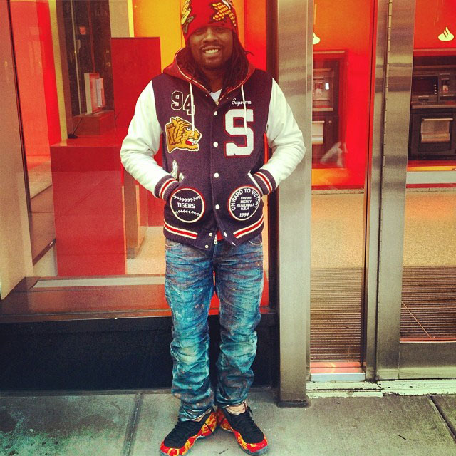 13c36126996 Wale wearing Nike Air Foamposite One Supreme Red