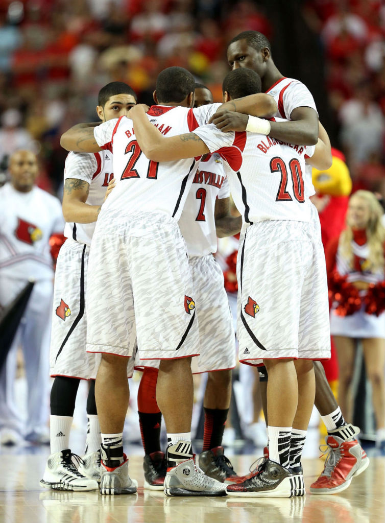 Louisville Cardinals wearing adidas Basketball