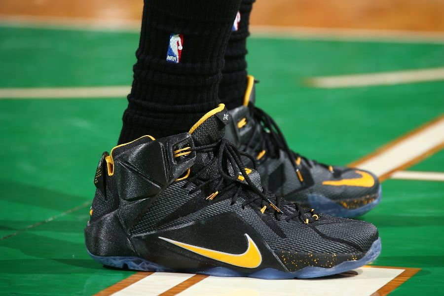 wholesale dealer de342 f8556 LeBron James wearing Nike LeBron XII 12 Black Yellow PE on November 14, 2014