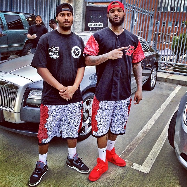 The Game wearing Nike Air Yeezy II 2 Red October