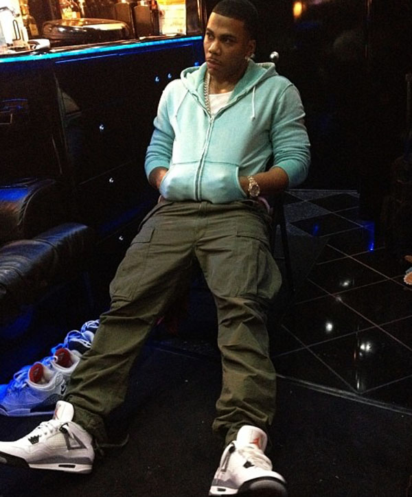 Nelly wearing Air Jordan 4 Retro Cement