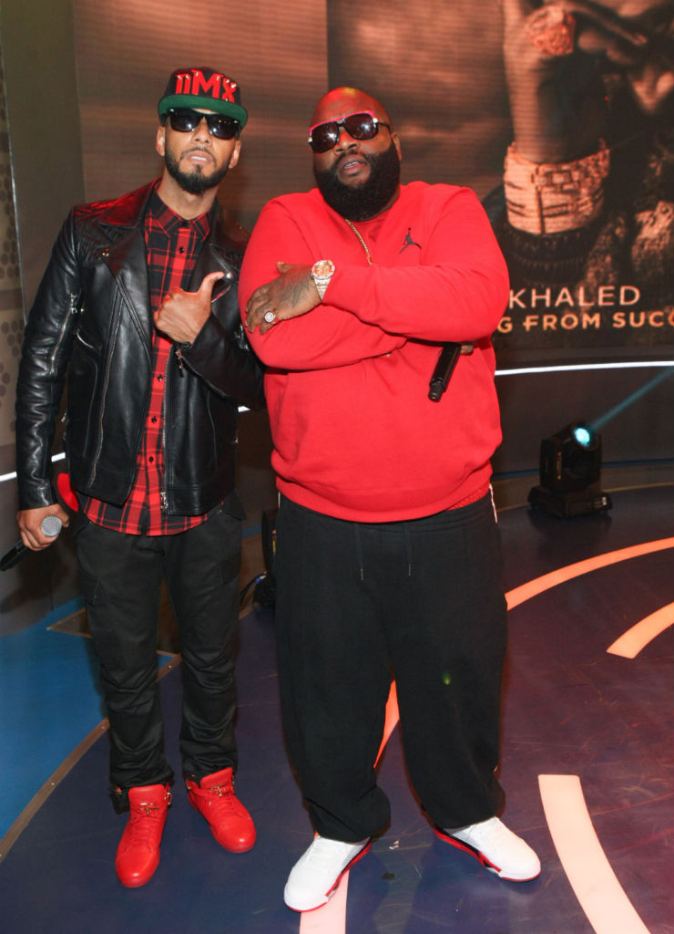 Swizz Beatz wearing Buscemi 100mm; Rick Ross wearing Air Jordan 5 V Retro Fire Red