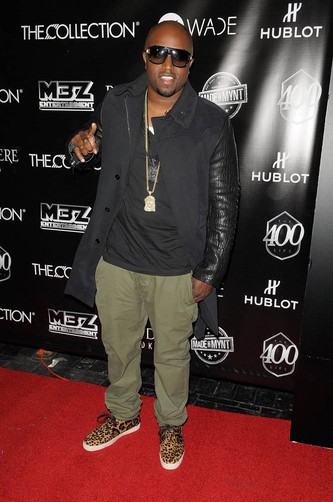 Rico Love wearing Christian Louboutin Leopard Sneakers