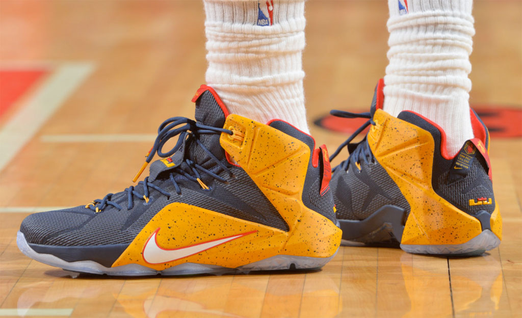 more photos 70a66 5c614 LeBron James wearing a Navy Yellow-Red Nike LeBron XII 12 Playoffs PE (