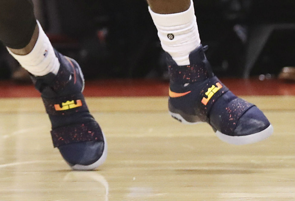 LeBron James Wearing a Cavs Navy Nike LeBron Soldier 10 PE Shoes