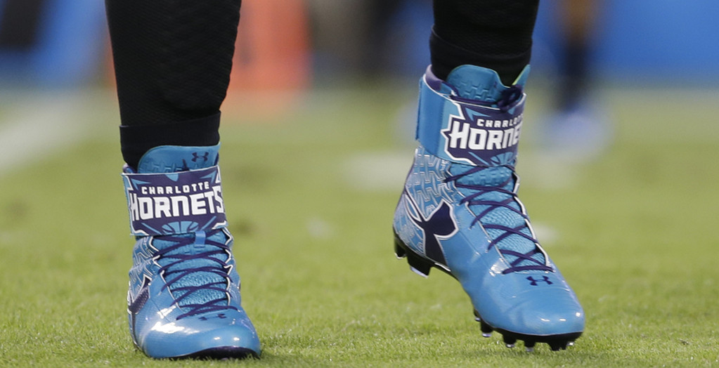 27c5f8636fb7 Cam Newton Salutes the Charlotte Hornets with Under Armour Football ...