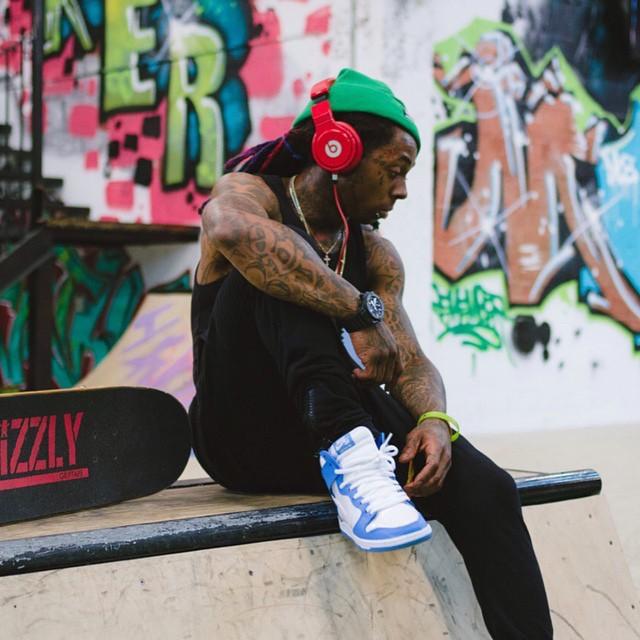 e7a19b38db31 Lil  Wayne wearing the  UNC  Nike Dunk High SB