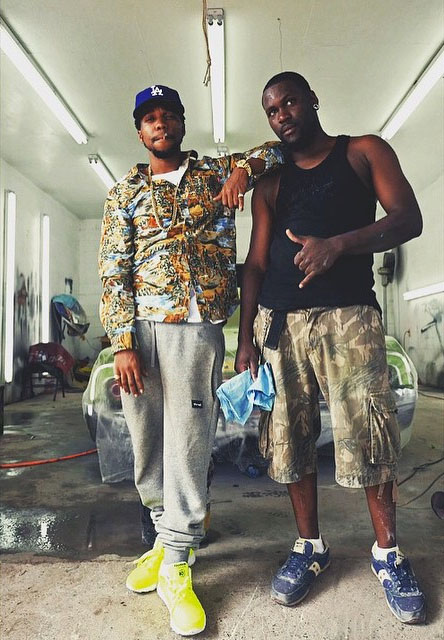 Currensy wearing the 'Solar Yellow' Reebok Ventilator
