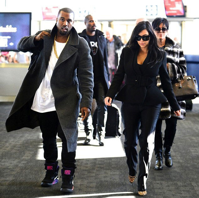Kanye West wearing Nike Air Force 180 Mid Suns (2)
