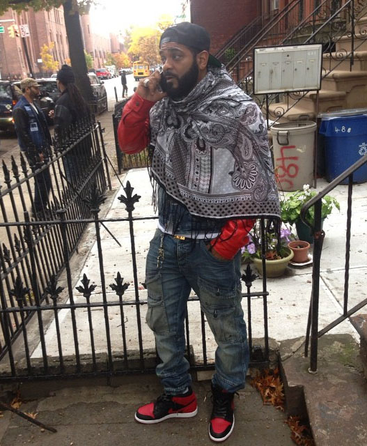 Jim Jones wearing Air Jordan I 1 Bred