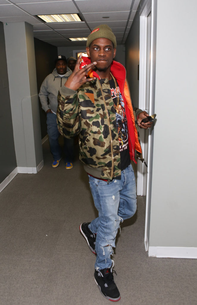 A$AP Nast wearing Air Jordan 4 Retro Black/Cement