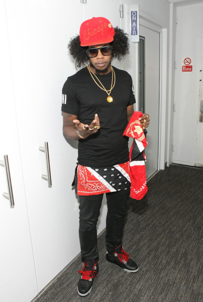Trinidad James wearing Air Jordan IV 4 Retro Black Laser (1)