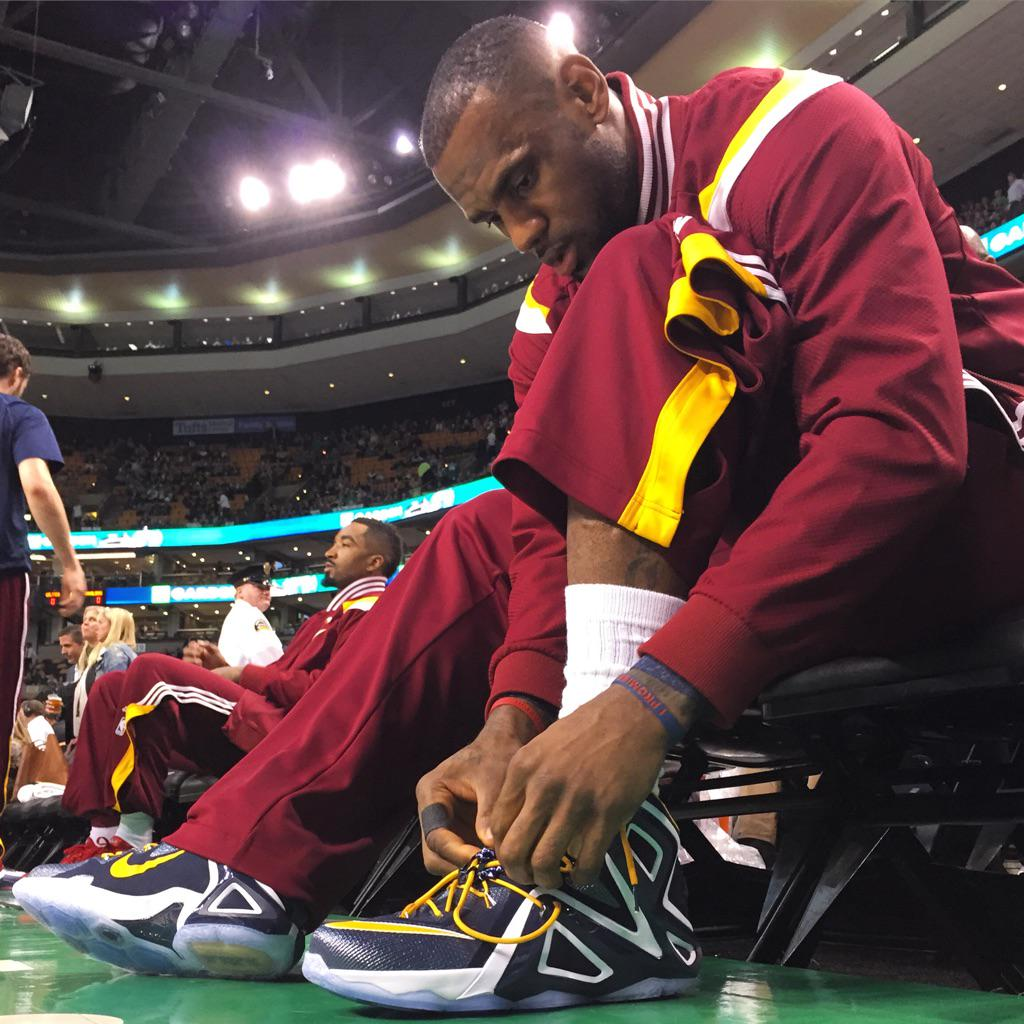 on sale e2118 223e3 ... new zealand lebron james wearing navy white yellow nike lebron xii 12 pe  1 9dc59 f681f