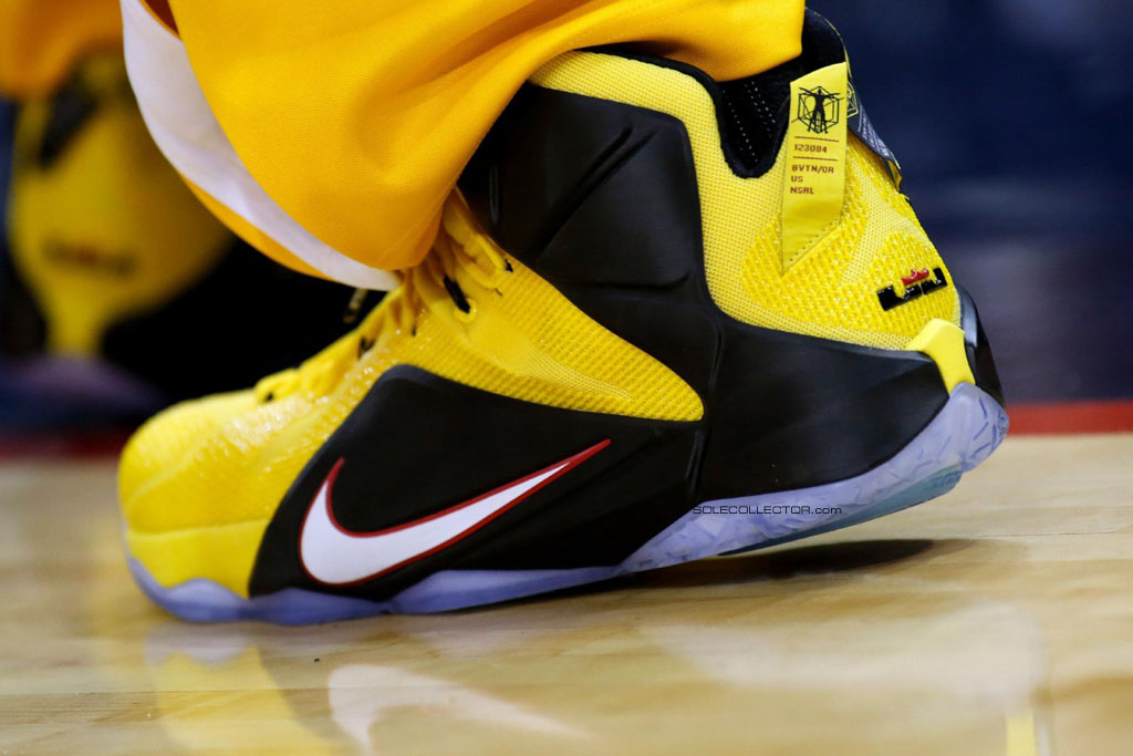 new concept b9927 4aebe LeBron James wearing Nike LeBron XII 12 Yellow Black-Red Taxi PE on December