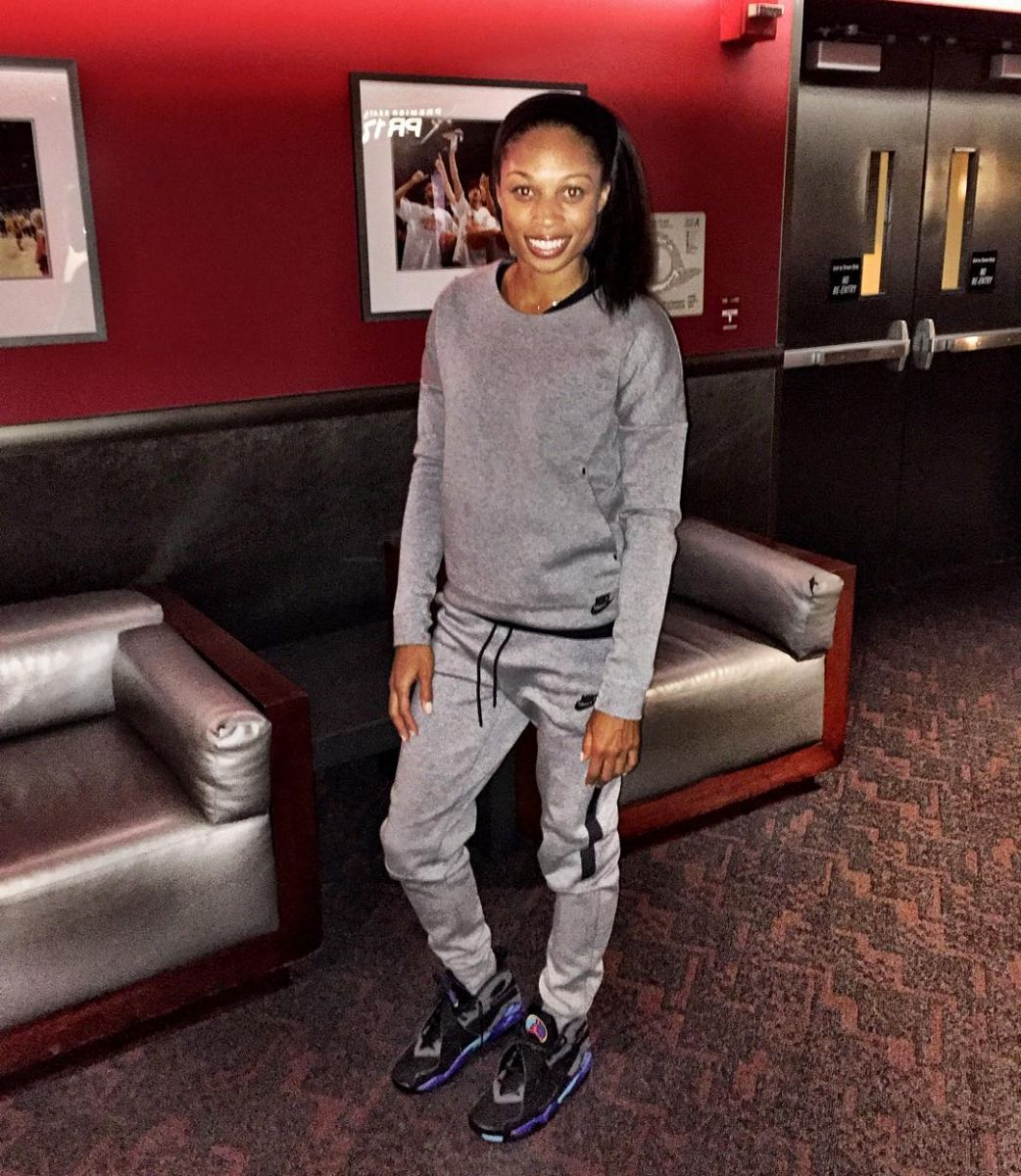 Allyson Felix wearing the 'Aqua' Air Jordan 8