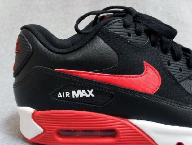 648c8a192ac The Black Sport Red Air Max 90 Essential is expected to hit select Nike  Sportswear accounts early next year.