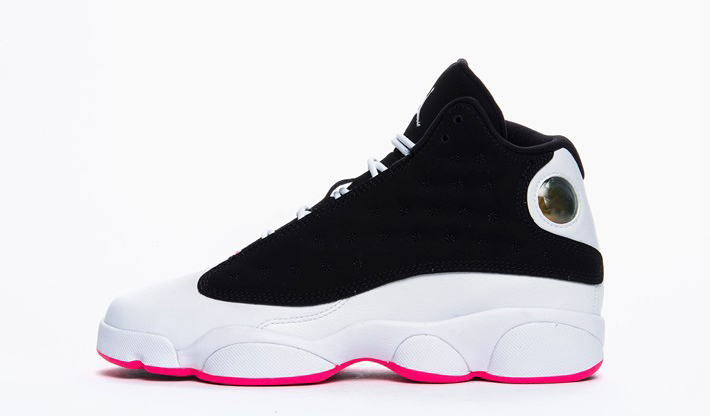 226c59cb7055 A GS pair of the AIr Jordan 13 that wears pink