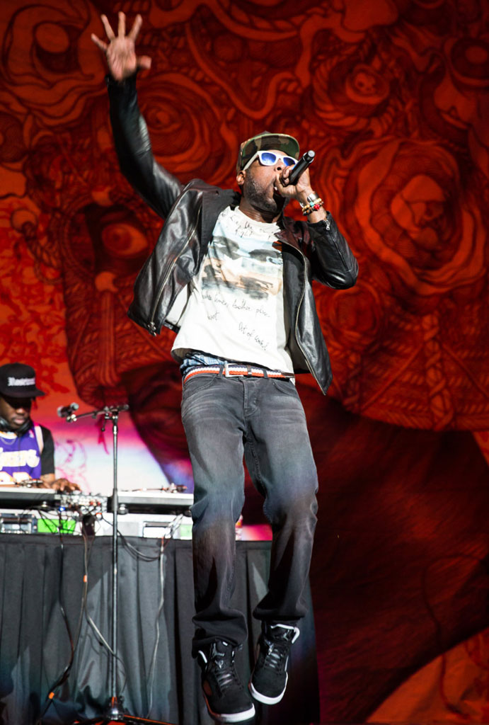 Talib Kweli wearing Air Jordan 5 Retro Oreo
