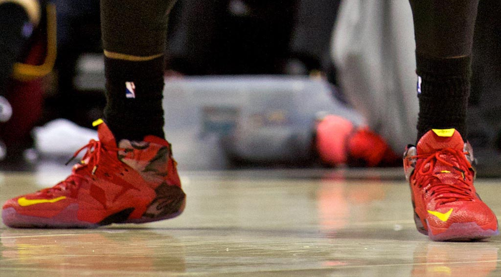 LeBron James wearing Nike LeBron XII 12 Red/BlackYellow PE on November 4, 2014