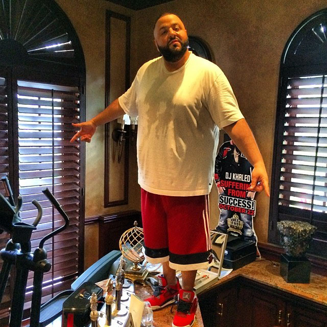DJ Khaled wearing Air Jordan 4 Retro Toro