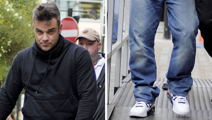 Robbie Williams wearing Nike Air Force 180 Olympic