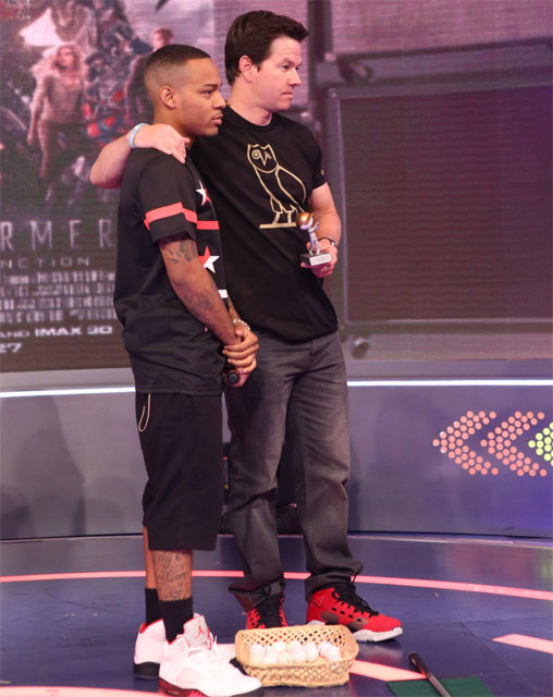 Bow Wow wearing Air Jordan V 5 Fire Red; Mark Wahlberg wearing Jordan 6-17-23