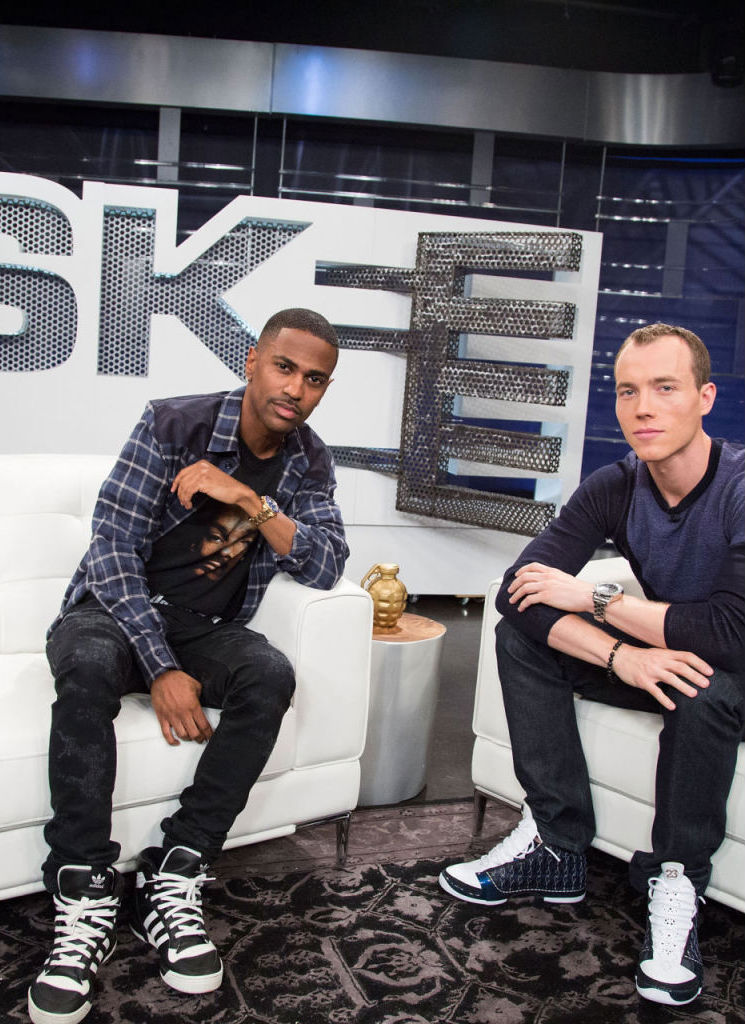 Big Sean wearing adidas Originals Rivalry Hi; DJ Skee wearing Air Jordan XX3 23 Wizards