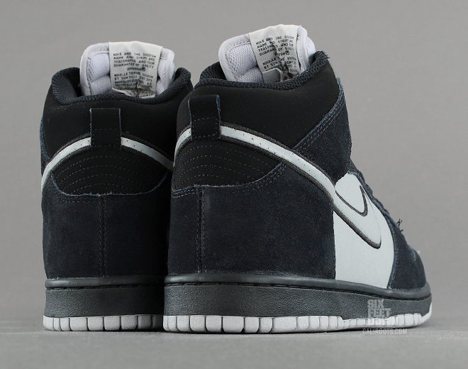 Nike Dunk High in black and reflective silver heel detail