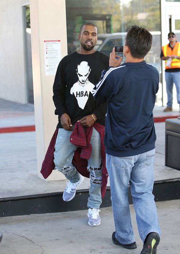 Kanye West wearing Nike Flyknit Trainer