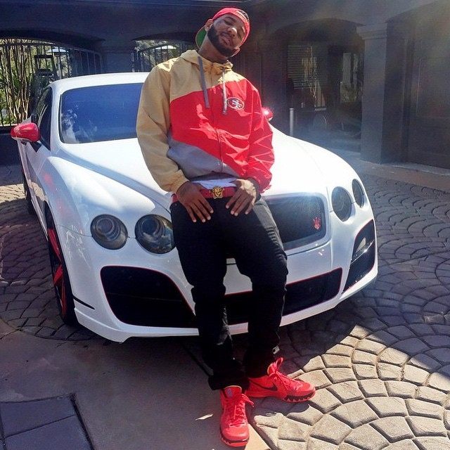 The Game wearing Nike Kyrie 1 Deceptive Red