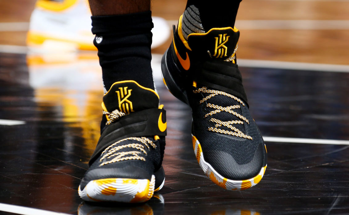 01a2bc538020 Kyrie Irving Wearing a Black Yellow-White Nike Kyrie 2 PE (1)