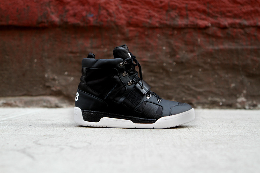 8ef4cd34a289 The adidas Y-3 by Yohji Yamamoto Fall 2012 offerings continue with a  stealthy black leather colorway of the Held high top sneaker.