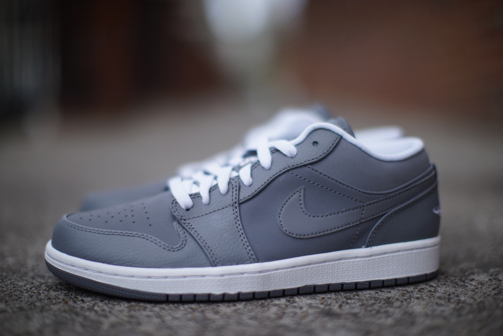 grey and white low top jordans