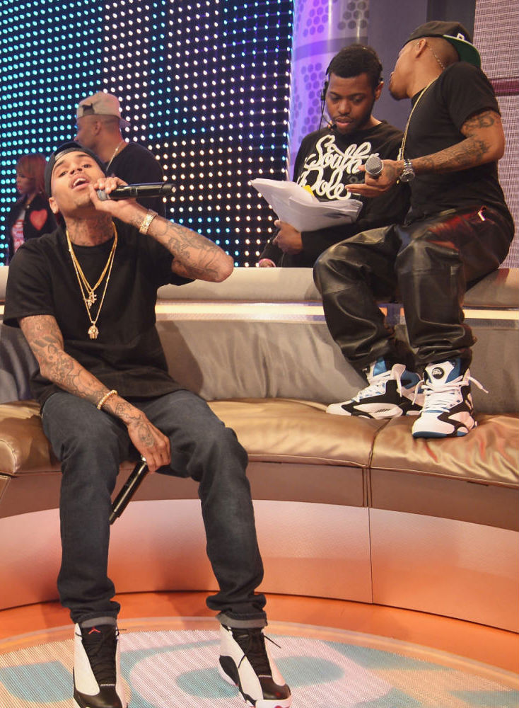 Bow Wow wearing Reebok Shaq Attaq; Chris Brown wearing Air Jordan XIII 13 White Black (2)