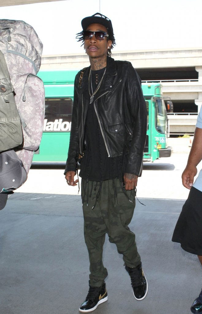 Wiz Khalifa wearing Air Jordan Retro I 1 Black Gold (1)