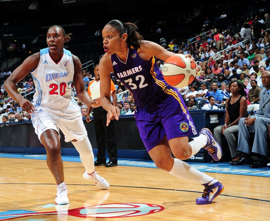 Tina Thompson wearing Nike Air Max LeBron 8 V/2
