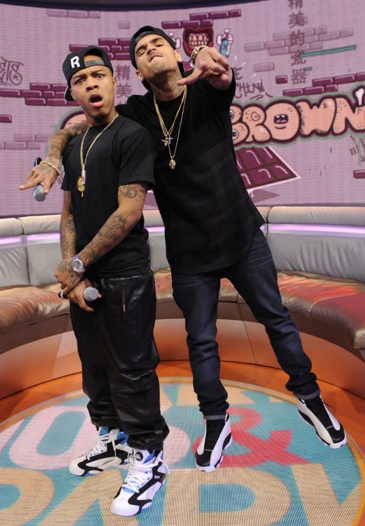 6079fc542672 Bow Wow wearing Reebok Shaq Attaq  Chris Brown wearing Air Jordan XIII 13  White Black